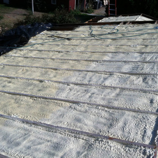 Insulation installation with protective roof coating in Meridian, ID